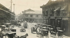 Old photo of Manila's streets with Bahay na bato edifices and kalesa, Filipino style of architecture and transportation developed during the Spanish era