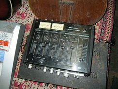 A small four-channel mixer that could be used for a singer-guitarist's performance at a small coffeehouse.