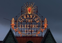 The Historic Electric City sign, restored in 2008, shines again