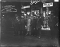 Men outside a shop in St. Helen's Square around 1910