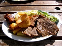 An English Sunday roast with roast beef, roast potatoes, vegetables and Yorkshire pudding