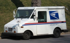 A United States Postal Service mail truck (a Grumman LLV) in the United States
