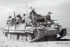 A Valentine tank in North Africa, carrying British infantry
