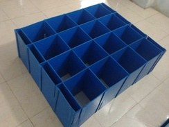 Corrugated plastic dividers used to pack automotive components.