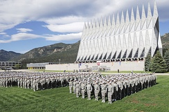 More than 1,300 basic cadets salute during the ceremonial Oath of Office formation on 26 June 2009. The Cadet Chapel is in the background.