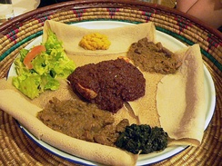 This meal, consisting of injera and several kinds of wat (stew), is typical of Ethiopian and Eritrean cuisine.
