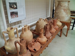 In pre-literate society, the distinctive shape of amphorae provided potential consumers with information about goods and quality. Pictured: Amphorae for wine and oil, Archaeological Museum, Dion.