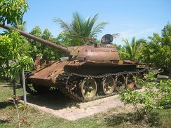 A memorial of a T-54/Type 59 tank in Siem Reap commemorating the overthrow of US/RVN-backed Lon Nol and the end of the civil war by the PAVN and GRUNK