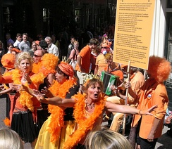 People dressed in orange in Amsterdam during Queen's Day in 2007