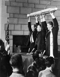 William Hayward Pickering, James Van Allen, and Wernher von Braun display a full-scale model of Explorer 1 at a Washington, DC news conference after confirmation the satellite was in orbit