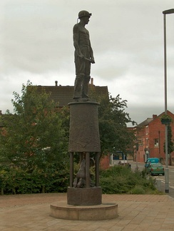 Bronze statue commemorating the lost mining industry, to be seen near Hucknall tram and railway station. The main figure is on top of a Davy lamp, whilst another collier is depicted hewing coal inside the lamp glass.