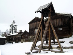 The 17th-century town of Røros, designated in 1980 as a UNESCO World Heritage Site, has narrow streets and wooden houses.