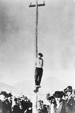 John Heath's corpse hanging from a telegraph pole in Arizona after being lynched on February 22, 1884.
