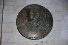 Medallion honoring Kazantzakis in the Venetian loggia of Heraklion