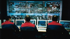 A DCS control room where plant information and controls are displayed on computer graphics screens. The operators are seated as they can view and control any part of the process from their screens, whilst retaining a plant overview.