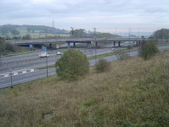 M1 at Junction 4. The old overhead lane control gantries are still visible, which were replaced with newer, verge-mounted MS4 variable message signs in 2008.