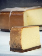 Cheesecake, a type of dessert with a layer of a mixture of soft, fresh cheese, eggs and sugar