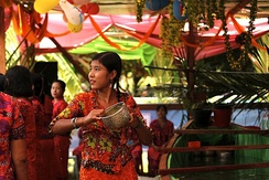 An Arakan (Rakhine) girl pours water at revellers during the Burmese New Year Thingyan Water Festival in Yangon.