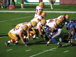 The Redskins gather at the line of scrimmage against the New York Giants