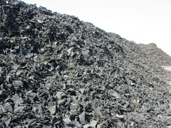 Mounds of shredded rubber tires ready for processing