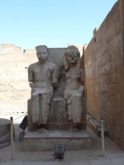 Statue of Tutankhamun and Ankhesenamun at Luxor, hacked at during the damnatio memoriae campaign against the Amarna era pharaohs