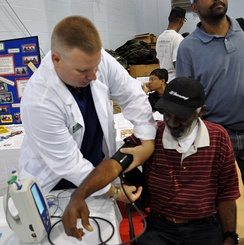 Student nurse at Jacksonville University School of Nursing takes the blood pressure of a homeless veteran during the annual Stand Down for Homelessness activity in Savannah, Georgia.