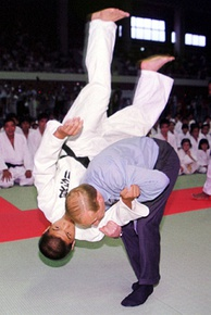 Putin practises judo with a student during a visit to Japan, at the G8 summit