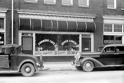 "Separate ""white"" and ""colored"" entrances to a café in North Carolina, 1940"