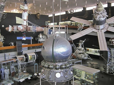 The Hall of Space Technology in the Tsiolkovsky State Museum of the History of Cosmonautics, Kaluga, Russia. The exhibition includes the models and replicas of the following Russian inventions:the first satellite, Sputnik 1 (the ball shape under the ceiling)the first spacesuits (lower-left corner)the first human spaceflight module, Vostok 1 (center)the first Molniya-type satellite (upper right corner)the first space rover, Lunokhod 1 (eight-wheeled vehicle bottom-right)the first space station, Salyut 1 (left)the first modular space station, Mir (upper left)