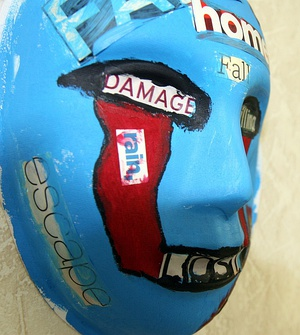 A mask, painted by a Marine who attends art therapy to relieve post-traumatic stress disorder symptoms, USMC-120503-M-9426J-001.jpg