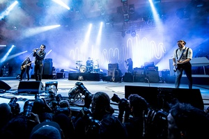 Arctic Monkeys performing at the Roskilde Festival in 2014