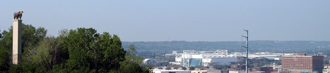 The American Hereford Association bull and Kemper Arena and the Kansas City Live Stock Exchange Building in the former Kansas City Stockyard of the West Bottoms as seen from Quality Hill