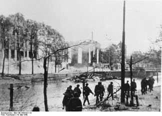 German troops advance through a destroyed section of Rotterdam.