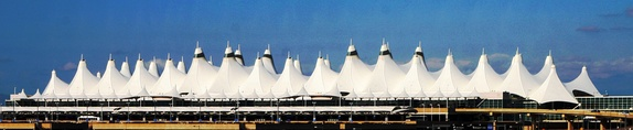 The minimal surfaces of the fabric roof of Denver International Airport, completed in 1995, evoke Colorado's snow-capped mountains and the teepee tents of Native Americans.