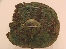Disc-headed pin depicting a female figure as decoration. Found in Lorestan, Rietberg Museum, Zürich