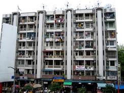 A block of appartements in down-town Yangon, facing Bogyoke Market. Much of Yangon's urban population resides in densely populated flats.