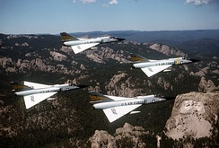 5th FIS F-106As flying past Mt. Rushmore in 1981