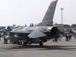 A USAF F-16 displaying its rear tailerons, which move independently of each other to provide both pitch and roll control. Note the different attack angles visible.