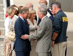 The Prince of Wales and the Duchess of Cornwall meeting Federal Emergency Management Agency officials in Louisiana, as they arrive to tour the damage created by Hurricane Katrina, November 2005