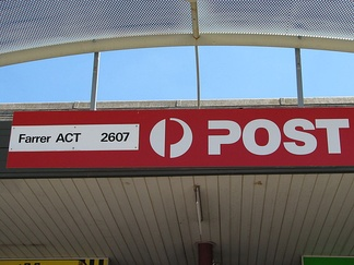 Post office sign in Farrer, Australian Capital Territory showing postcode 2607