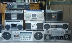 "An assortment of radio-cassette players, aka ghetto-blasters or ""boomboxes"""