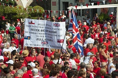 Thousands of Gibraltarians dress in their national colours of red and white during the 2013 Gibraltar National Day celebrations. Gibraltarians were the only group of overseas territories residents who could apply for full British citizenship without restrictions before 2002.