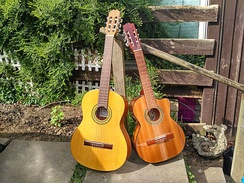A classical guitar (left) and a requinto guitar (right)