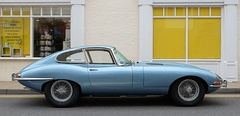 "Front-engine, rear-wheel drive coupe: 1964 Jaguar E-Type. Automotive designers call the position of the driver's hip close to the rear axle ""close-coupled"".[22]"