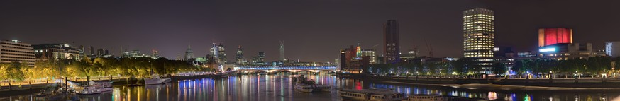 Facing east; towards the City of London, from Waterloo Bridge.  Showing St. Paul's, and other major City buildings – to the right, the illuminated National Theatre.