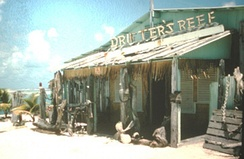 "The original Drifter's Reef bar, built near the harbor area at Wake Island, opened its doors to aircrews, visitors and other ""drifters"" on November 8, 1949."