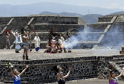 The Pan American Games torch being lit in Teotihuacan.