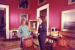 Pat Nixon with White House curator Clement Conger, whom she hired, in the Red Room after her redecorations, 1971