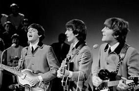 Paul McCartney, George Harrison and John Lennon of the Beatles performing on Dutch TV in 1964