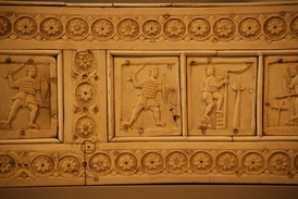A 10th-12th century ivory relief of a Roman swordsman wearing scale armor and round shield- Berlin Bode museum.